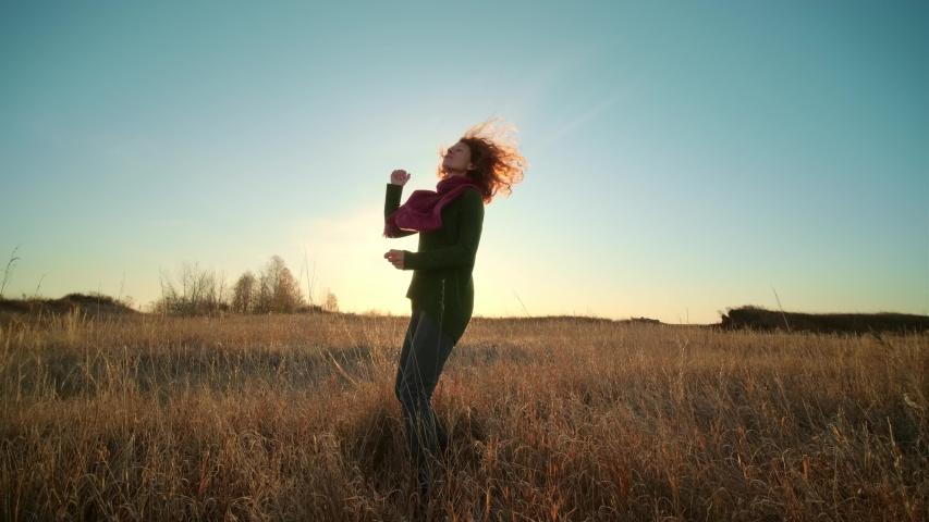 Autumn landscape, woman traveler having fun at sunrise | Shutterstock HD Video #1040613905