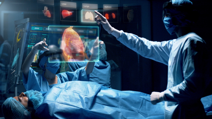 Group of surgeons using augmented reality holographic holo lens headsets interacting with a virtual interface showing patient organs. Doctor analyses LUNGS. Shot on RED Epic W Helium 8K Cinema Camera. | Shutterstock HD Video #1040687405