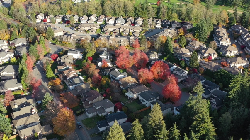 Houses in suburb with Fall Foliage in the north America. Luxury houses with nice yellow and red coloured landscape. Aerial drone view. 4K. | Shutterstock HD Video #1040694725