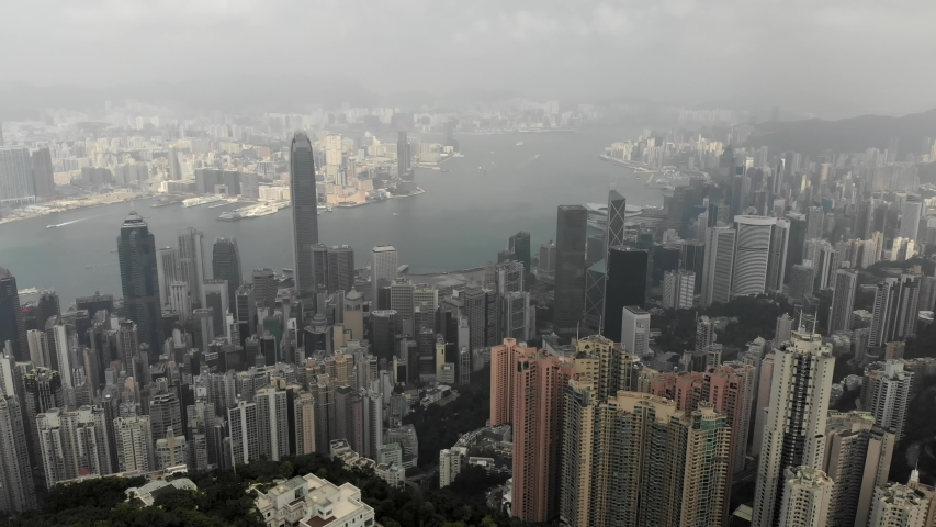Aerial view from Victoria Peak in Hong Kong. Residential buildings, business centers, Victoria Bay.   Shutterstock HD Video #1040818955