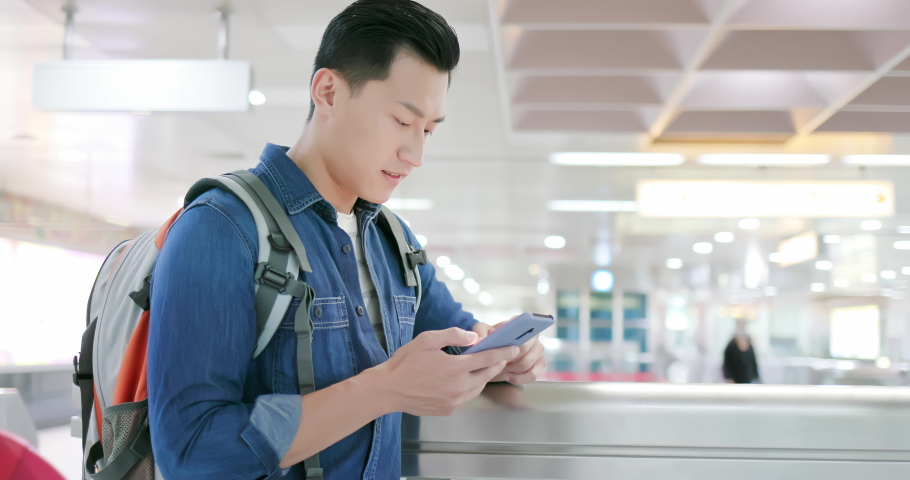 Asian young man use 5g smartphone on the mrt station | Shutterstock HD Video #1040827265