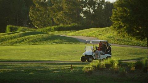 Caucasian Couple Golfer Play Global Golf Resort Buggy Cart Transport