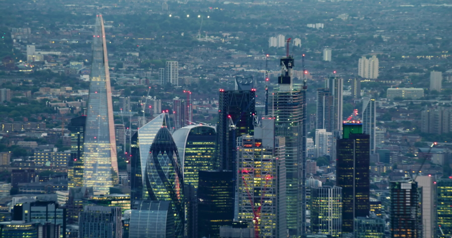 Aerial view of London's financial district skyscrapers. The city famous buildings. This is one of the financial centers of London. Cityscape at dawn. England. UK. | Shutterstock HD Video #1040869235