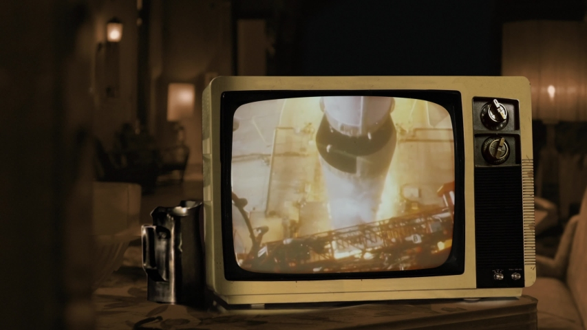 Apollo 11 launches from Kennedy Space Center Cape Canaveral in 1969. Seen on a Retro TV. Sepia Tone. Elements of this video furnished by NASA. 4K Resolution.  | Shutterstock HD Video #1040910755