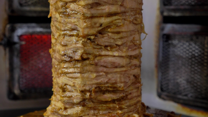 Large Gyros skewer spinning in a local restaurant. | Shutterstock HD Video #1040970785
