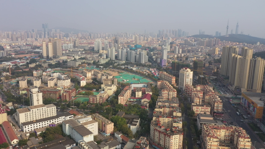 QINGDAO, CHINA – SEPTEMBER 2019: China city planning and renovation - aerial view of old disappearing neighborhoods and sprawling city of Qingdao | Shutterstock HD Video #1040989235