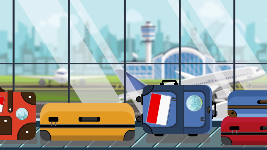 Luggage with Indonesian flag stickers on baggage carousel in airport, close-up. Tourism in Indonesia related loopable cartoon animation | Shutterstock HD Video #1041071285