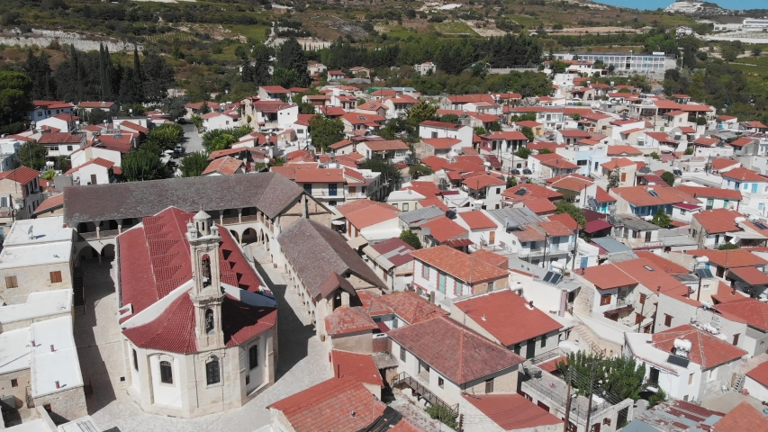 Panorama of the village of Omodos, (Cyprus) with Monastery of the Holy Cross (The Monastery of Timios and Zoopoi Stavros). Videography from a drone. | Shutterstock HD Video #1041078505