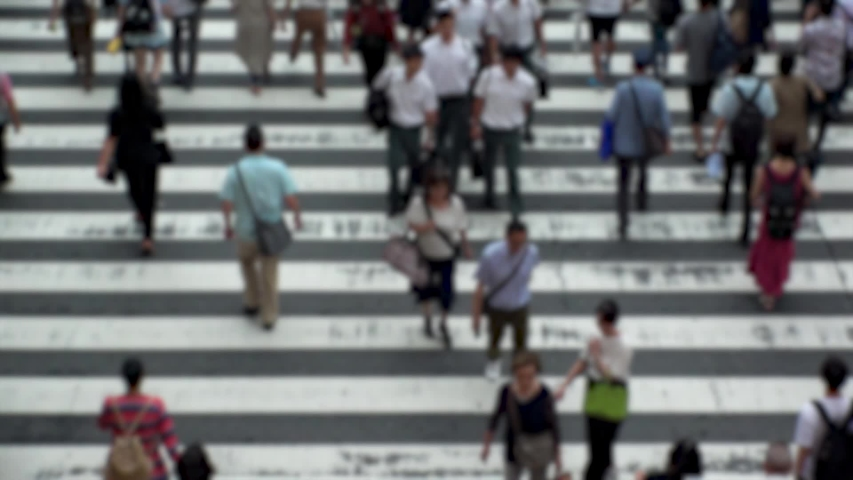 UMEDA, OSAKA, JAPAN - CIRCA SEPTEMBER 2019 : Aerial blurred high angle view of zebra crossing near Osaka train station. Crowd of people at the street. Shot in busy rush hour. Wide slow motion. | Shutterstock HD Video #1041098755