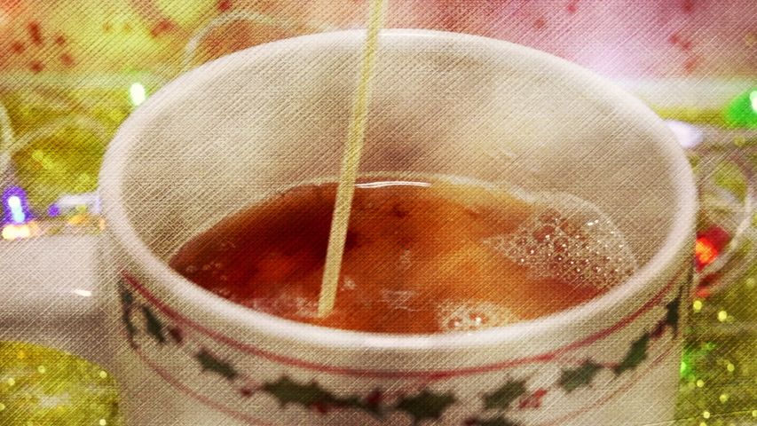 Preparing a cup of tea during Christmas season. Digital texture and color effect applied | Shutterstock HD Video #1041130435