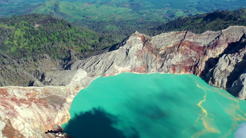 Ijen Volcano, Crater. Birch Sulfur Lake Kawah Ijen. Flight over the lake, video shooting from the air. Java Island, Indonesia.