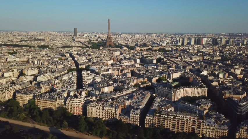 Paris, France. Aerial top view of old historical cityscape. Eiffel Tower on the background. Taken by drone at early morning. Drone flying over the amazing cityscape   | Shutterstock HD Video #1041280645