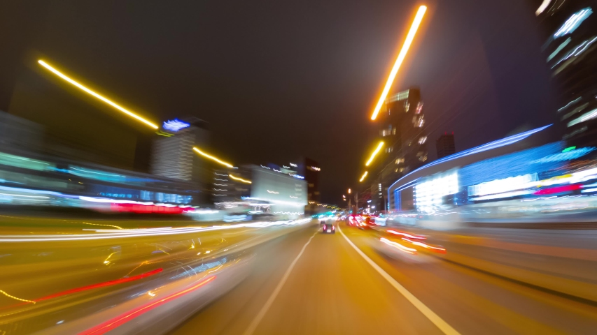 Vilnius, Lithuania - circa October, 2019: Driving in a city at night, time-lapse #1041387235