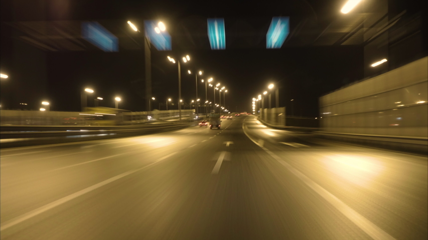 Driving Car On Street City At Dark. Time Lapse. Evening Street Lights. Camera In Front, Windshield Reference. Hyperlapse. Driving Car POV On Road Urban In Of Night In With Bright Lights Traffic. | Shutterstock HD Video #1041455785