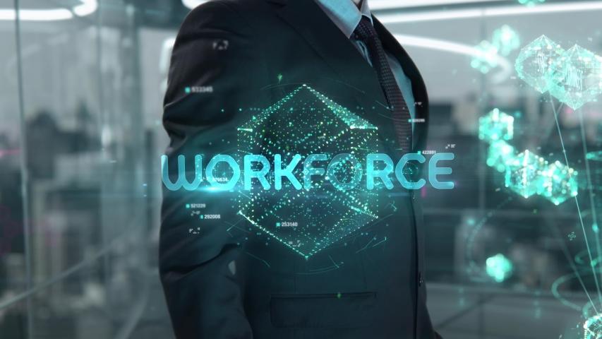 Businessman with Workforce hologram concept   Shutterstock HD Video #1041460255