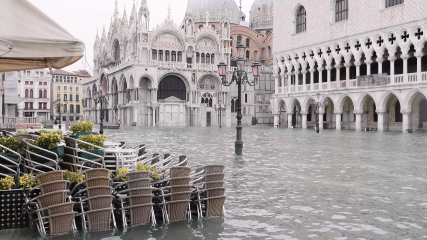Saint Mark's square flooded, high tide affecting the beautiful church in Venice, Italy. 4k	Saint Mark's Basilica in Venice  | Shutterstock HD Video #1041552265