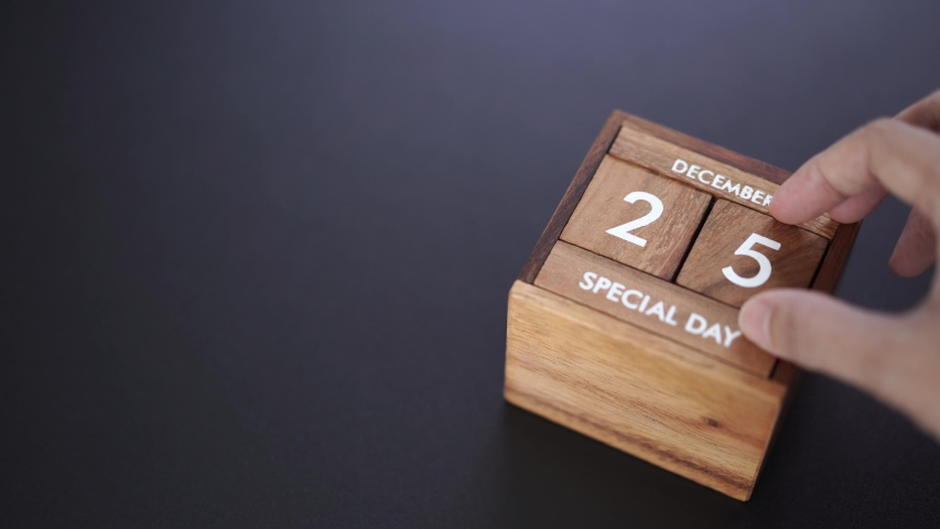Day and month of special day of year fill into wooden cube calendar, copy space on left | Shutterstock HD Video #1042247935