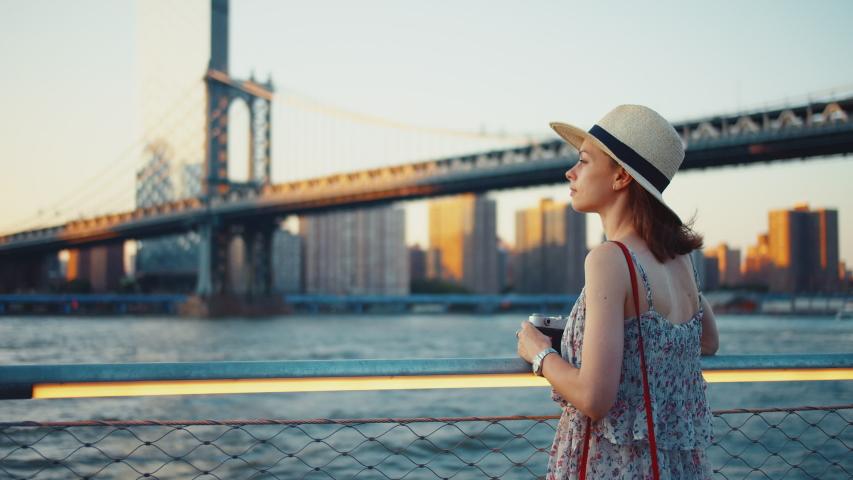 Young tourist taking photo at Manhattan bridge in New York | Shutterstock HD Video #1042248775