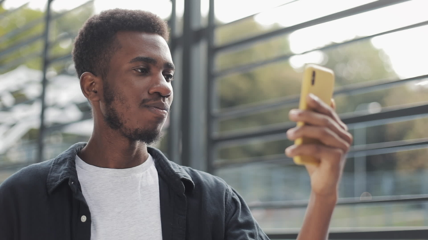 Close up of guy having a video call using smartphone.   Shutterstock HD Video #1042267615