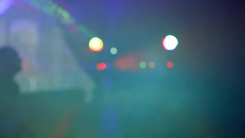 People dancing at party. Unrecognizable silhouette crowd in nightclub with disco light.  soft focus   Shutterstock HD Video #1042346215