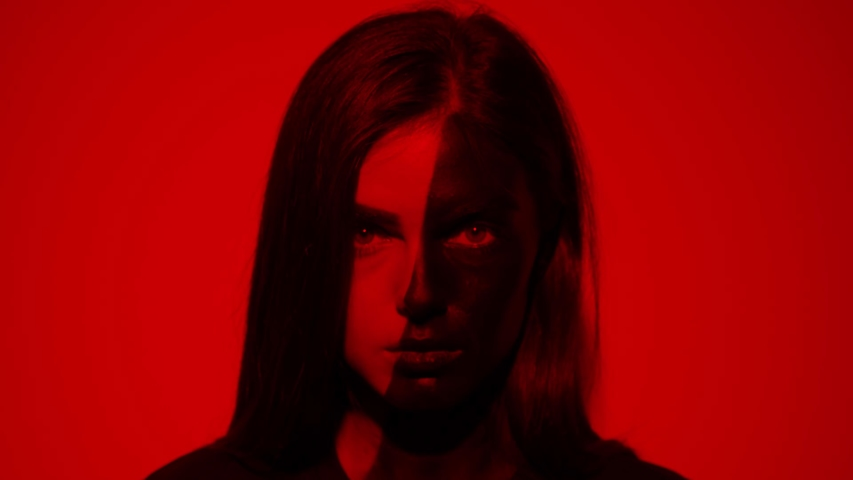 Portrait of attractive young woman half face girl drawn in black look at camera serious red light abstract art beauty artistic creative decoration design fashion slow motion | Shutterstock HD Video #1042456195