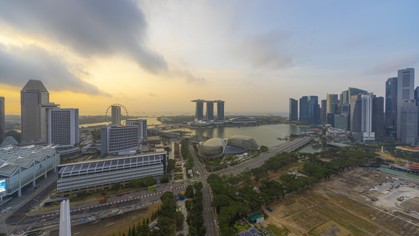 Singapore Beautiful Time lapse of Night to day of Singapore city skyline from aerial and high angle overlooking Marina bay and CBD area. Prores 4K | Shutterstock HD Video #1042483735
