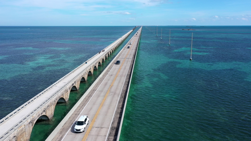 Aerial shot of the Seven Mile Bridge in Florida which connects several of the Florida Keys on the way to Key West | Shutterstock HD Video #1042489675