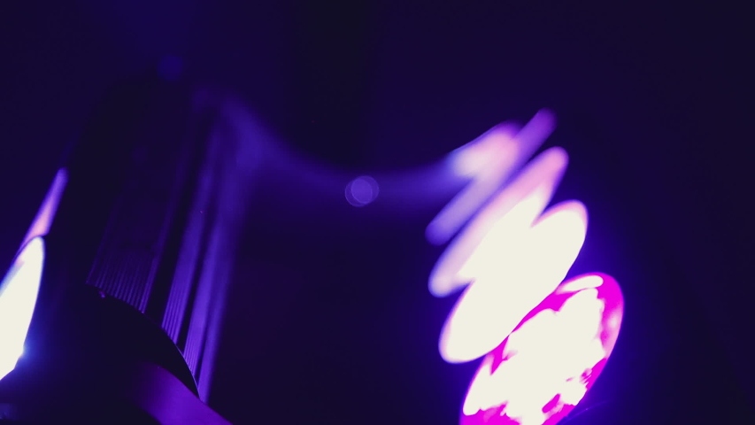 Close up slow motion shot, club party lights moving.   Shutterstock HD Video #1042491115