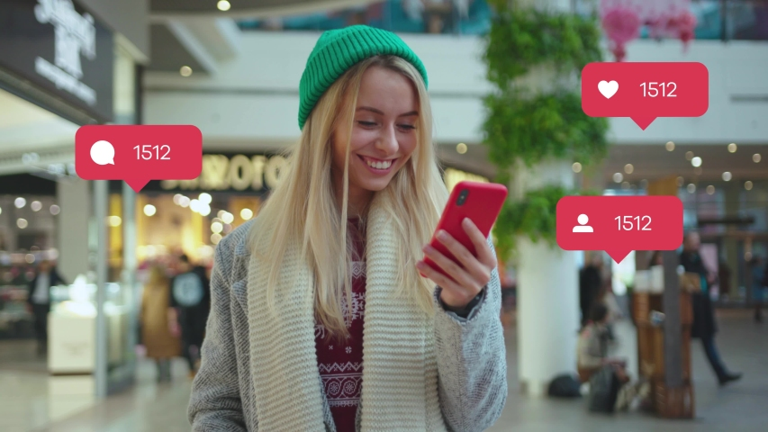 NEW YORK - April 5, 2019: Portrait smiling young woman use phone in shop mall typing social media icons with like comment follower counter quick increase blogger influencer adult communication slow | Shutterstock HD Video #1042499485