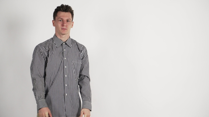 Blank space. A young white Guy doing a presentation on white background.  | Shutterstock HD Video #1042541125