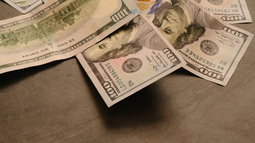 Many 100 usd dollars scattered on a background | Shutterstock HD Video #1042581775