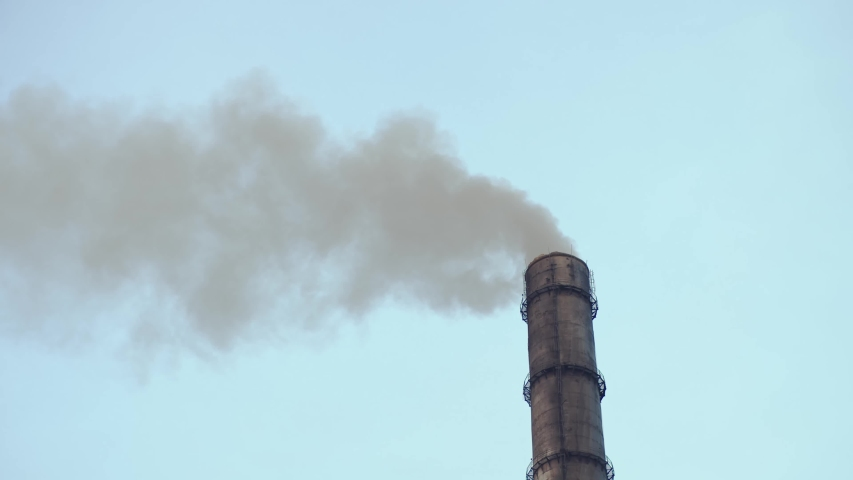 Industrial zone with large red and white pipe thick white smoke is poured from the factory pipe in contrast to blue sky. Air Pollution of environment. Global politics. Climate crisis. Dirty emissions. | Shutterstock HD Video #1042593445