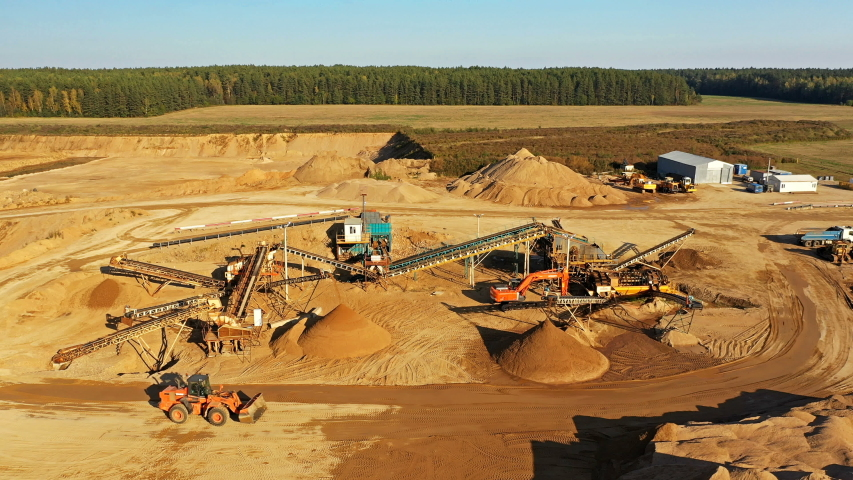 4K. Sand Quarry in working process with heavy machinery: sorting conveyor, bulldozers, excavators and trucks.  | Shutterstock HD Video #1042703005