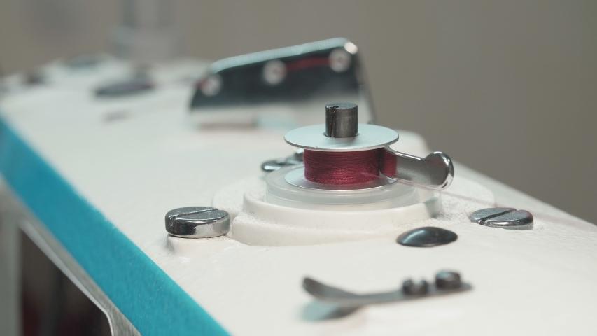 Shooting of spinning bobbin of thread | Shutterstock HD Video #1042722325