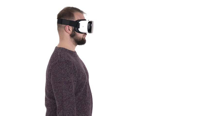 Man imitates retro phone using while wearing VR glasses. Digital age and new technologies | Shutterstock HD Video #1042778545