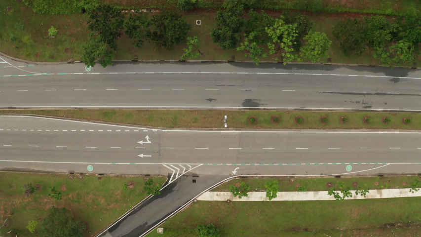Top down aerial view of an urban road in Cyberjaya City, Malaysia. Panning to the right. | Shutterstock HD Video #1042802695