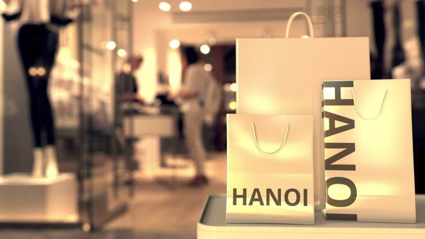Shopping bags with Hanoi text. Shopping in Vietnam related conceptual 3D animation | Shutterstock HD Video #1042820545