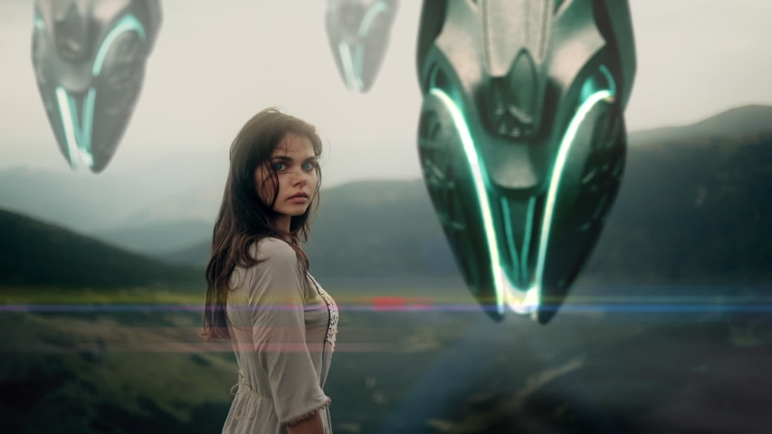 Young girl stands on top of a mountain on a background of landing spaceships. Alien spacecraft, star ship   Shutterstock HD Video #1043488315