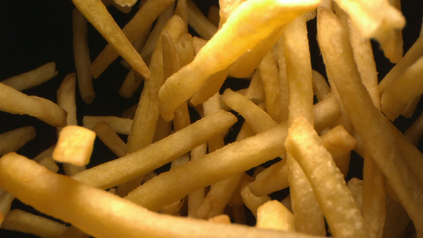 French Fries or Chips Floating in the Air Flying in Slow Motion on Black Background at 1500 fps 1080 version | Shutterstock HD Video #1043622655