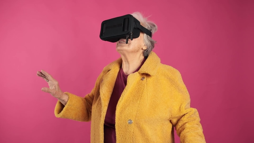 Very old grandma, dressed fashionably and youth use VR glasses. isolated, pink green screen background.