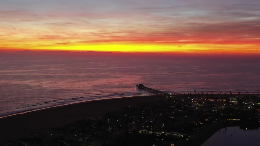 Aerial view or drone shot of beautiful pink sunset with horizon over Newport Beach, Orange County pier in California during twilight. | Shutterstock HD Video #1044260335