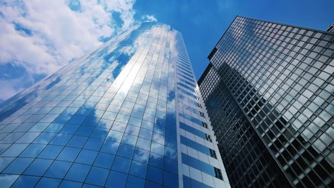 Sky and clouds reflecting over skyscrapers in New York City, time lapse