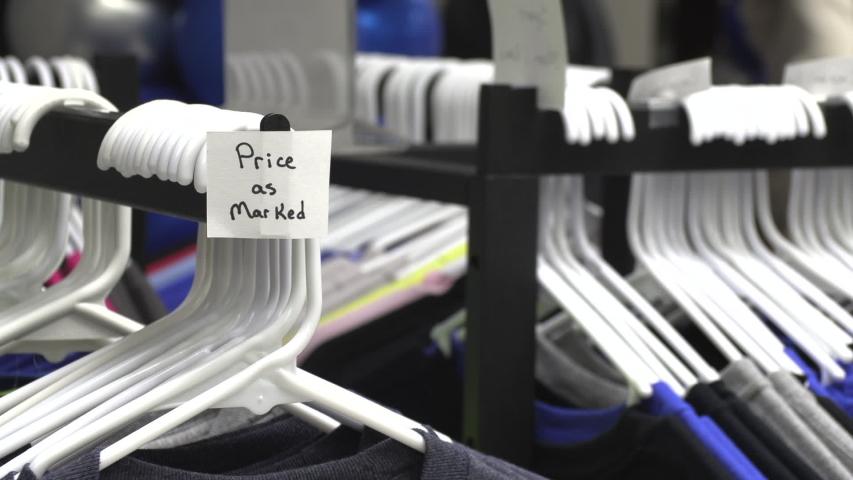 A sale rack of high school spirit wear | Shutterstock HD Video #1044780325