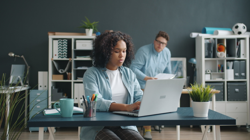 Business lady in casual clothing is working with laptop in office then cooperating with male colleague talking getting advice. Communication and job concept.   Shutterstock HD Video #1044817345