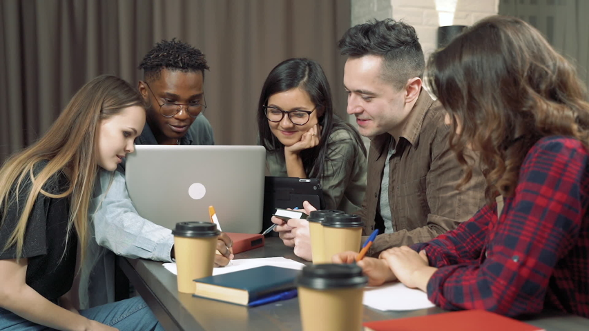 Meeting creative business team in modern office. Multiethnic group of young people discussing start-up idea   Shutterstock HD Video #1044847135