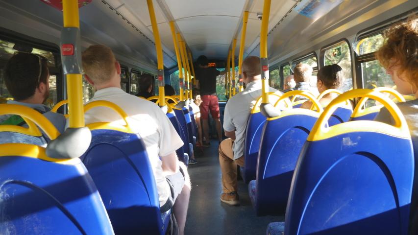 A view inside a double decker bus. | Shutterstock HD Video #1044944605