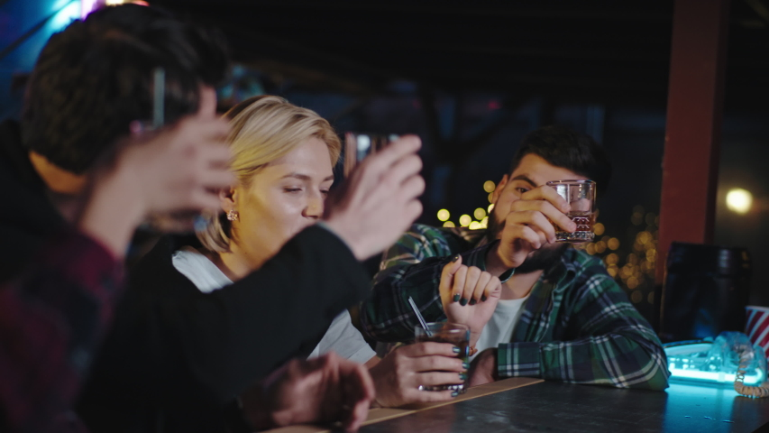 Happy evening together with group of friends charismatic and good looking celebrating something in a bar they cheers with cocktails and enjoying the time together | Shutterstock HD Video #1044967825