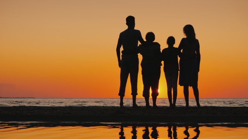 Friendly multi-generational family together standing next to the sea, looking at the horizon | Shutterstock HD Video #1045008145