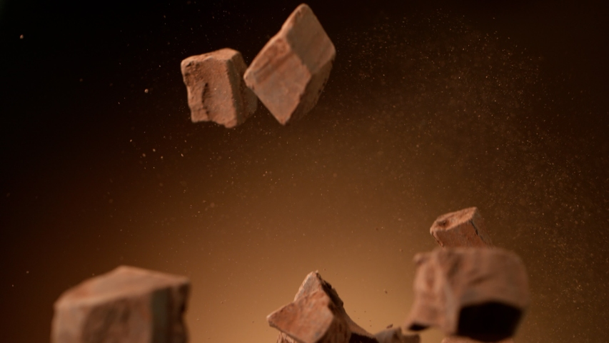 Super slow motion of flying group of raw chocolate pieces on black background. Filmed on high speed cinema camera, 1000fps. | Shutterstock HD Video #1045117315