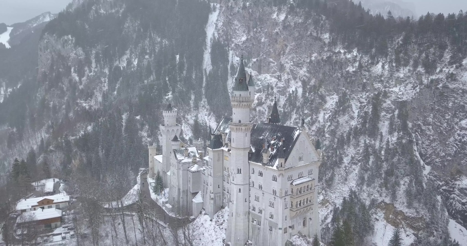 Neuschwanstein Castle in Winter Day . Mountains and Rocks. Bavarian Alps, Germany. Aerial View. Wide Shot. Drone is Orbiting Clockwise | Shutterstock HD Video #1045193245